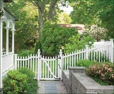 Victorian elegance. The airy, open-picket Sudbury fence & gate  has a pleasing scallop-top gate with sphere top post caps and decorative brace rail.