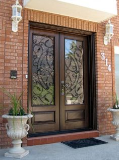 Chateau rustic mahogany entry door custom entry doors black custom wood door with wrought iron insert wood doors toronto presented by m doors manufacturer of custom wood doors and wrought iron inserts eventshaper