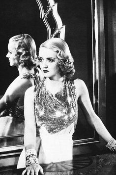 "Bette Davis in a gown by Orry Kelly for ""The rich are always with us"" (1932)."