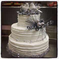 3 tier winter wonderland wedding cake. Silver glitter decoration with rough base icing.