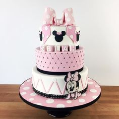 This three-tier Minnie Mouse-inspired cake is an overload of cute pastel!  by charmcitycakes