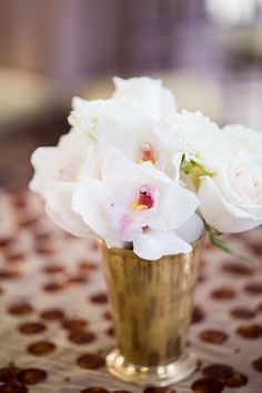Posies | Julep Cup with Orchids & Roses | On Style Me Pretty: http://www.StyleMePretty.com/2014/03/13/new-york-athletic-club-wedding/ Photography: Kelsey Combe