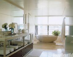 """designer Vicente Wolf placed Clodagh Collection's Zen cast-concrete tub on a concrete slab inside the glassed-in shower enclosure to make it """"a sculptural focal point."""""""