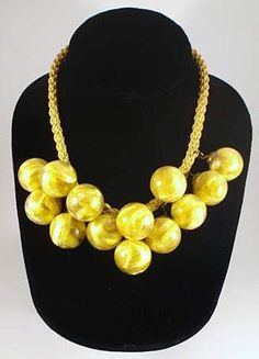 Vintage 1930s Delicate Glass Ball Necklace Sunshine Yellow. $100.00, via Etsy.