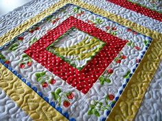 rick rack quilt...perhaps I could stretch my French Chickens into a larger quilt with a few additional fabrics...