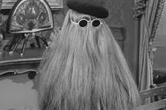Cousin Itt is a member of the fictional Addams Family. Unlike the other characters, Cousin Itt was not originally created by cartoonist Charles Addams, but by producer David Levy. Itt is the cousin of Gomez Addams and is arguably the most enigmatic member of The Addams Family. He is short and his entire body is shrouded by long hair, which changed color through the years but in the 1998 Addams Family TV series, his hair color was blond.