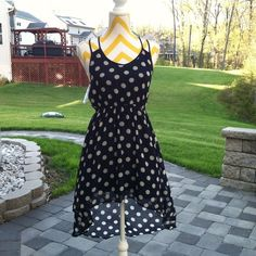 polka dot chiffon hi low dress Chiffon polka dot dress with caged detail at back, lined at front and bottom, top back is sheer. Never worn, NWOT. Dresses High Low