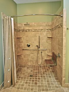 """curbless shower on a budget with curved shower curtain rod for more space inside shower; teak fold down seat a nice touch for added texture and color"