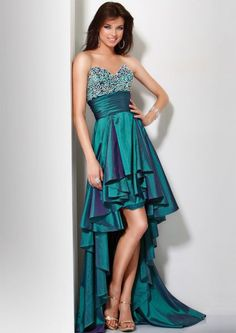 prom gown is a litmus calypso, made with fabric with bright silver applications on top, at the bottom has the same color taffeta and a belt at the front of the knee begins and ends with a fall the ankles, carried golden shoes with high heels, accessories are a rhinestone ring and bracelet of the same type, and a teardrop-shaped hoops