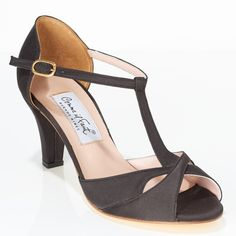 www.felinashoes.com Argentine Tango Shoes from Comme il Faut shoes. Butterfly front, single ankle strap, enclosed heel cage. Black satin, black satin heel, beige leather sole. Sizes 4 (34), Size 5 (35), Size 6 (36), Size 7 (37), Size 8 (38), Size 9 (39), Size 10 (40), Size 11 (41)