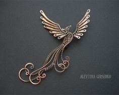 The phoenix is very meaningful for me. This piece would make a fabulous pin.