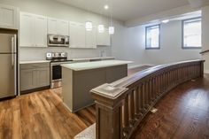 The altar rail (also known as a communion rail or chancel rail). A beautiful restoration of a wonderful community building. Kitchen and Bath Cabinets provide by KBC Direct.