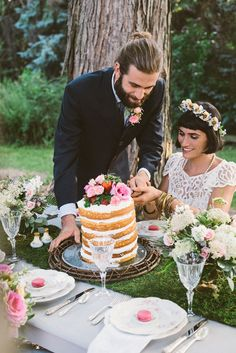 A six-tiered naked cake was topped with pink roses and strawberries and set atop a grapevine and glass serving tray [2 of 3]