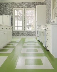 Green and white stenciled floor. Fresh. Clean. Simple. Fun. If paint and stenciling scare you, something similar can also be done with solid colored linoleum squares.