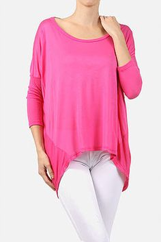 Oversized, relaxed, jersey top with a round neckline and high-low neckline.  100% Modal  Hand Wash Cold / Hang Or Line Dry  Available only in Hot Pink