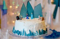 This is the best Disney Frozen Cake! It has an Ice Candy Mountain, whipped cream topping, FROZEN figurines and it also has ice cream inside!