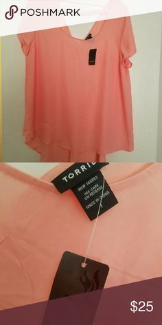 Torrid hi-lo pink top NWT The shirt is the Hi-Lo type it is a pink or Peach is colored shirt the silky material so it doesn't have any stretch. It is a size 1 Torrid brand brand new with tag torrid Tops Blouses