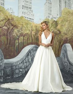 Justin Alexander 8937 Ivory/Silver/Nude Size 14 This look embodies the new clean trend with a structured Mikado V-neckline with couture seaming at the waist. Box pleats create volume and the hand beaded illusion back adds a unique element of surprise. https://www.justinalexanderbridal.com/wedding_dresses/8937