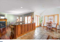 Kitchen half-wall has cabinets