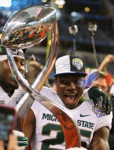 Keith Mumphery #25 of the Michigan State Spartans celebrates a 42-41 win against the Baylor Bears during the Goodyear Cotton Bowl Classic at AT&T Stadium on January 1, 2015 in Arlington, Texas. (Photo by Ronald Martinez/Getty Images)