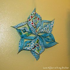 I have seen this done with paper - but this one is done with fabric - cool.