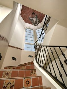 iron stairs-love this southwestern/morocan flair too! Spanish Tile, Spanish Colonial, Banisters, Railings, Wrought Iron Staircase, Mediterranean Tile, Staircase Remodel, Moorish, Stairs