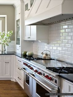 Subway Tile Kitchens black subway tiles - except i'd do them in blue! lov love with the