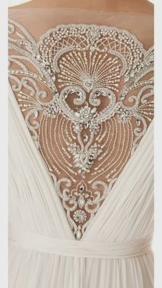 Gorgeous detailing. Its a perfect wedding dress!! oh yeah it is !!