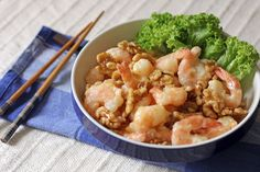 Honey Walnut Prawns or Honey Walnut Shrimps is a Chinese-American dish that is made out of deep fried lightly breaded prawns with candied walnuts served in a creamy style mayonnaise sauce.
