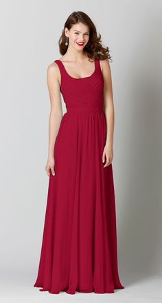 Kennedy Blue Sophia is a stunning bridesmaid dress made of flowing crinkle chiffon fabric with a scoop neckline and tank straps. The bodice is filled with criss-crossing ruching and beautifully flows into the pleated A-line skirt. Shown in Raspberry.