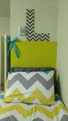 DIY College Dorm Headboard. Cardboard covered in fabric