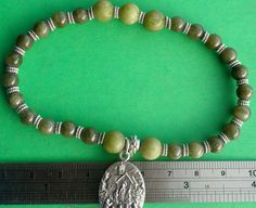 Irish Catholic Stretch Bracelet, Connemara Marble Beads, Lady of Knock Medal with Holy Water capsule, by VintageIrishDresser on Etsy