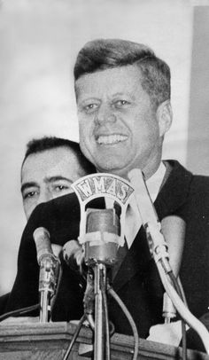 Thousands jam the Court Square area of Springfield as Sen. John F. Kennedy speaks on the Monday before the 1960 national election. Behind Kennedy is Springfield Mayor Thomas J. O'Connor.