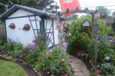 Shed with arch and perennial beds
