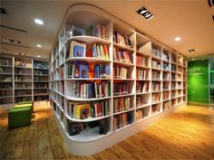 This white bookshelf design extends around the room to take advantage of existing space.