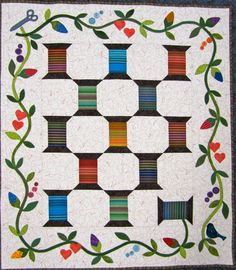 Laura's spool blocks | liking my skills are assembled using empty spools quilt patterns