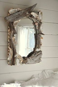 Using shells and driftwood to upgrade a mirror is a great idea. This one inspires me to perhaps incorporate rose colored quartz crystals in the design.