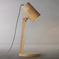 This stylish oak table lamp would be a charming lighting solution to illuminate any desk.Dimensions: H 42 x W 17 x D 17cm