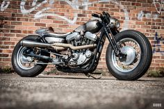 'El Cochino' is a showcase for traditional metalworking and fabrication skills. Part cafe racer, part bobber, this Harley-Davidson Sportster is all Win.
