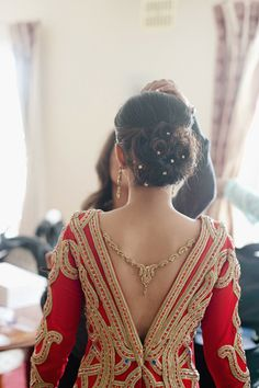 great idea for the back of a sari blouse or lehnga - use a necklace instead of a string or beads