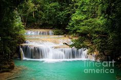 Stream with water cascades in the tropical jungle in Thailand.