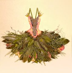 Fairy dress.  I love the dresses that look like they are made from real leaves and flowers. This one actually is made from flowers and leaves.