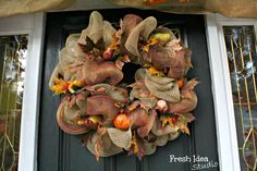 a Welcoming Fall Wreath makes a great focal point for an awesome Autumn porch - More Fall decorating tips at Fresh Idea Studio.com