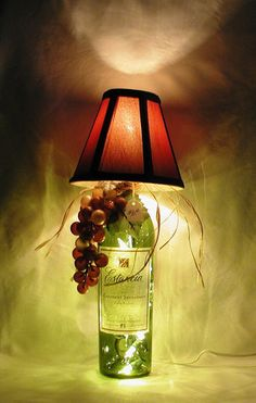 WINE BOTTLE LAMP.  Perfect for a corner, counter top, book case, wine bar or anywhere some ambiance is desired.  $30.00  See this and many other unique wine bottle lamp creations at crwinebottles.com