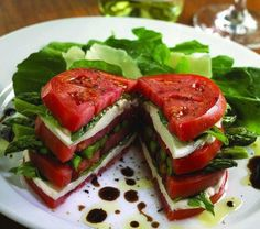 I am so going to try this soon! Stacked tomatoes, mozzarella cheese, basil and asparagus, drizzled with a bit of balsamic vinaigrette.