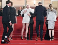 """Kristen Stewart Photos Photos - (FromL) Festival General Delegate Thierry Fremaux (C) embraces US actress Kristen Stewart  as she arrives with (FromL) German actor Lars Eidinger, French actress Sigrid Bouaziz, French director Olivier Assayas and Austrian actress Nora von Waldstatten  on May 17, 2016 for the screening of the film """"Personal Shopper"""" at the 69th Cannes Film Festival in Cannes, southern France. / AFP / ANNE-CHRISTINE POUJOULAT - 'Personal Shopper' - Red Carpet Arrivals - The…"""