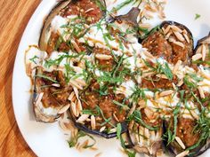 The intoxicating aromas of this Turkish dish of baked stuffed eggplant supposedly caused the Muslim priest for whom it was made to faint. Recipe for Fainting Imam ( Turkish Baked Stuffed Eggplant ) Baked Eggplant, Eggplant Recipes, Stuffed Eggplant, Serious Eats, Turkish Recipes, Ethnic Recipes, Lebanese Recipes, Vegetarian Recipes, Healthy Recipes