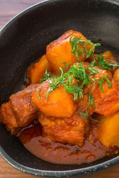 Pork belly and potatoes simmered in a tomato and preserved lemon sauce until fall-apart tender.