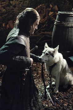 Lord Eddard Stark with his daughter Sansa's direwolf, Lady.