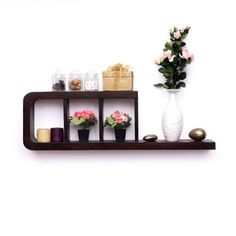 Uno Scandoff Wall Shelf - A modern wall accent with bracketed shelves will add elegance to your workspace. This Scandoff wall shelf utilizes space and looks glamorous.A tropical fruit wood construction, this wall shelf is durable and looks classy with the warm walnut finish. Storage comes handy with defined shelves. Use it to simplify your workspace or living area. Salient Features:* An exquisite item that has been handcrafted and boasts of refined craftsmanship* Crafted from superior ...